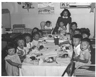 A historic birthday photo of a child's birthday party