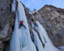 Ice climber Vern Nelson Jr. climbing in a majestic WI5 formation in Cody Wyoming.