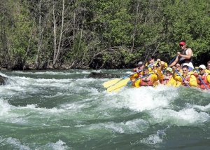 A group of tourists on an exciting rapids journey
