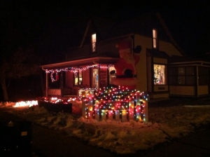 A home brightly lit with Christmas lights.