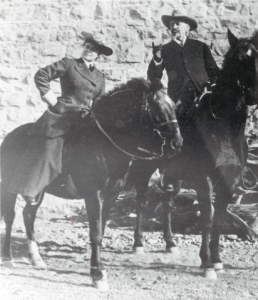 Caroline Lockhart and a Coloneal on horseback