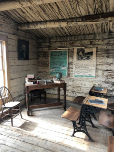 Antique benches and a teacher's desk in the Coffin School