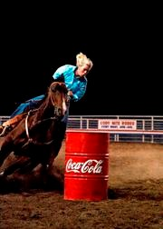 A rider competes in barrel racing