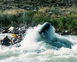 Tour group experiencing an thrilling rafting adventure on the Red Canyon River