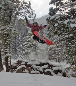 Individual snowboarding over a ramp