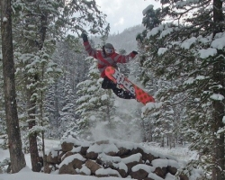 snowboarder jumps into the air