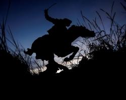 The silhouette of Buffalo Bill on horseback