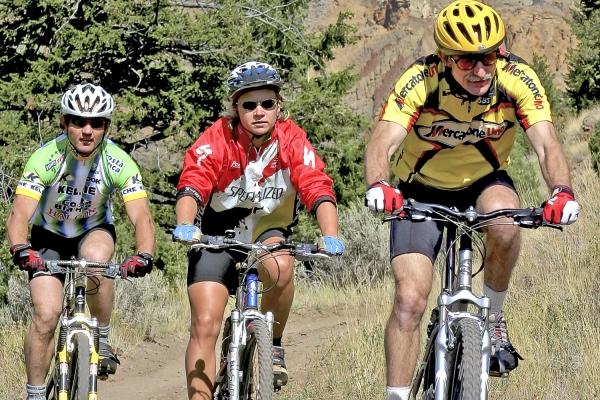 Three individuals enjoying a bike ride