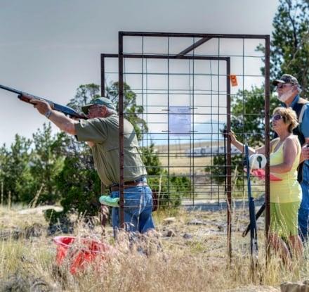 Man taking a shot at target shooting