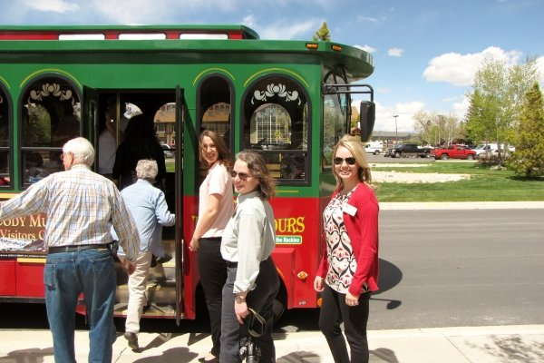 A family boarding the trolly in Cody