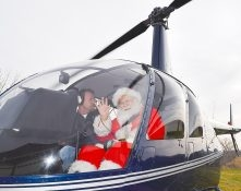 Santa arriving in a helicopter