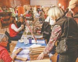 Individuals selling Christmas gifts at a bazaar