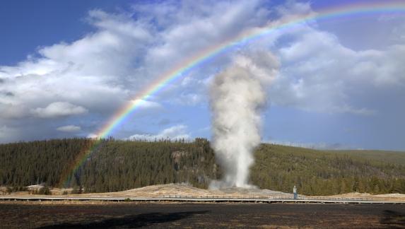 Old Faithful Geyser with rainbow