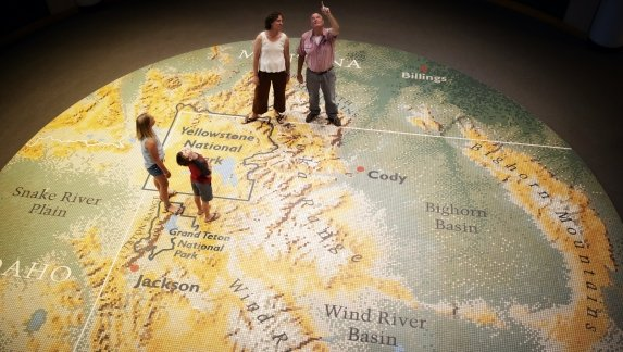 Visitors stand on a giant map in the Buffalo Bill Center of the West