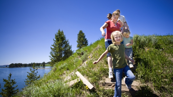 Kids walking with parents through Yellowstone National Park