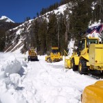 snow plows plowing road