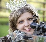 beauty queen holding rifle