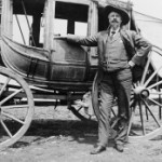 Buffalo Bill standing in front of a stagecoach