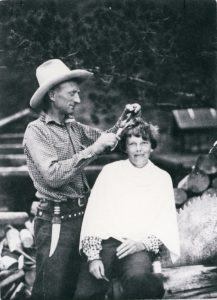 Carl Dunrud cutting the hair of Amelia Earhart 1934. Image courtesy of Jim and Joan Dunrud.