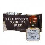 Yellowstone National Park sign with closed sign next to it