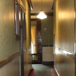 ghostly image in hotel hallway