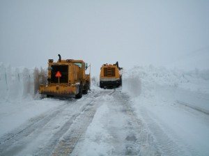 Plows clear snow on highways to make way for visitors