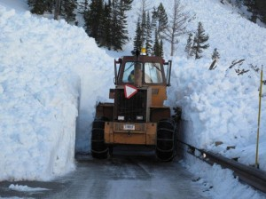 It takes weeks for plows to clear snow and ice from the Cody/Yellowstone East Entrance Road.