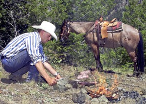 A cowboy cooks over an open fire in Cody/Yellowstone Country.