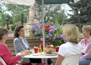 A group of ladies enjoy a meal at a restaurant in Cody/Yellowstone Country.