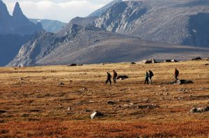 Hikers make their way across the rugged landscape of Cody/Yellowstone Country.
