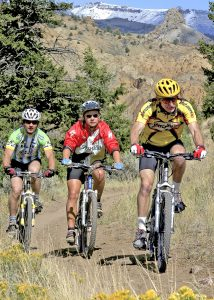 Mountain bikers ride up the Beartooth mountains in Cody/Yellowstone Country.