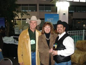 Attendees show off their best western wear at an art exhibit in Cody/Yellowstone Country.