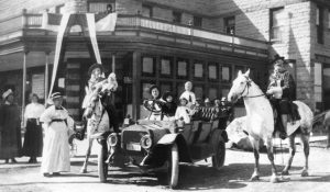 Buffalo Bill Cody and family stand in front of the Irma Hotel in Cody, Wyoming.