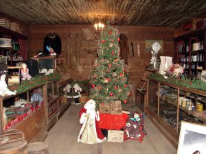 The rustic cabins at Trail Town are decorated for the Christmas Open House
