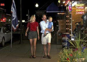 A family strolls along Sheridan Avenue in Cody, Wyoming.