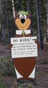 A Yogi Bear sign warning of the dangers of bears in Yellowstone National Park.