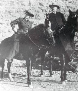 Caroline Lockhart and Bill Cody pose for a picture on horseback.