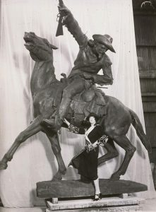 "Gertrude Vanderbilt poses with ""The Scout""—a sculpture of Bill Cody on horseback."