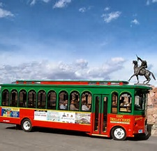 The Cody Trolley Tour drives past the statue of Buffalo Bill in Cody/Yellowstone Country.