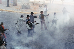 Actors recreate a gun duel during a performance of the Cody Gunfighters.
