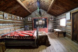 The interior of Curley's Cabin, located in Old Trail Town.