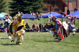 Two dancers in traditional dress perform at the Plains Indian Powwow.