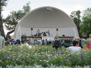 A quartet plays on stage under the band shell in Cody City Park.