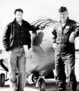 Actors Sam Shepard and Chuck Yeager stand in from of an airplane on the set of The Right Stuff.