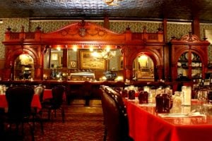 A Cherrywood bar in the dining room of the Irma Hotel was gifted to Buffalo Bill Cody by England's Queen Victoria after his Wild West Show performed for the queen's Golden Jubilee.