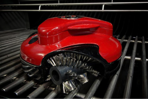 A red grillbot on a barbecue