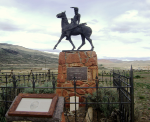 The grave of Jeremiah Johnston, featuring a statue of Johnston riding a horse atop a stone monument.