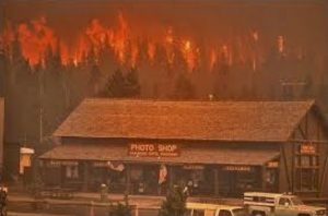 Fire encroaches upon Old Faithful Village during the 1988 forest fires.