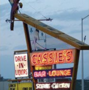 A neon sign advertising Cassie's Bar and Lounge in Cody, Wyoming