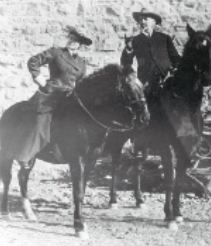 Caroline Lockhart riding her horse alongside a companion